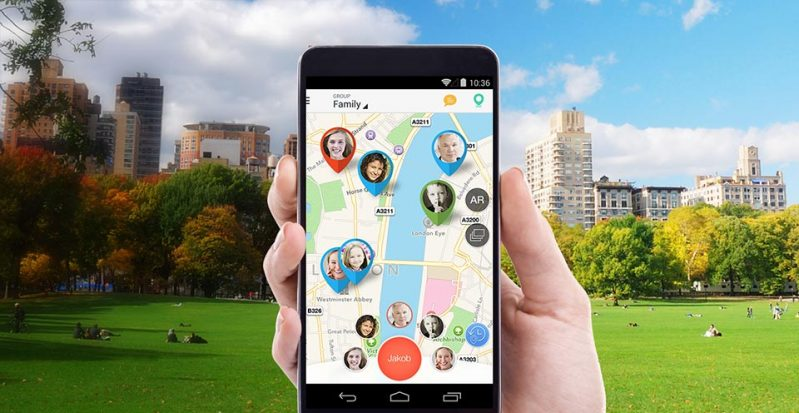 smartphone with family locator application turned on which shows location of family members on the map