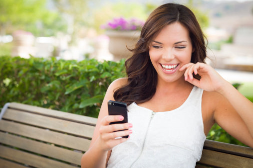 girl looking on her smartphone and smiling