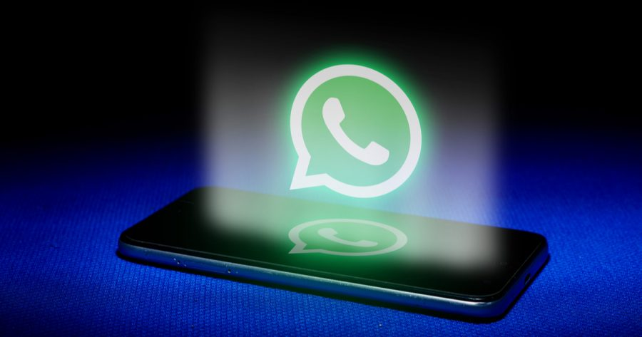 Hologram of whatsapp logo. hologram whatsapp logo image on blue background . The concept of next technology,social media